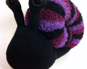 small sock snail, black with purple hues and black shell