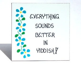 Yiddish humor magnet - Humorous quote about Jewish language, blue flowers, green leaves design