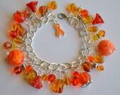 Enzo Charm Bracelet in Orange and Gold with Swarovski Crystals for Childhood Leukemia Awareness