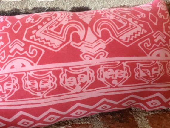 Upcycled Boho tshirt pillow in rose with Indian inspired print featuring images of horses, face masks, and diamond shapes