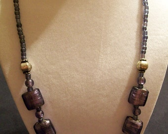 Purple and silver beaded necklace.