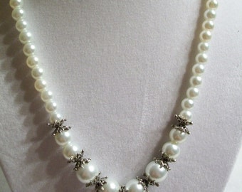 White glass pearl and silver necklace.