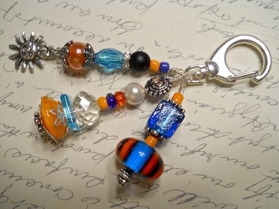 Aqua and Orange Decorative Clip with Sun Charm