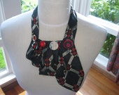 Upcycled tie necklace in blue, red and silver - a cleverly transformed necktie with careful folding and handstitching.