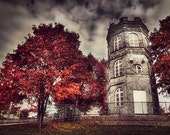 White tower of autumn, surreal photo, red trees, Finland
