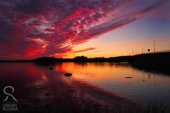 Dramatic sunset in Finland over a lake, surreal photo, print you can frame for your wall