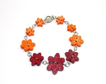 Flower button bracelet in orange and maroon, silver toned, button jewelry