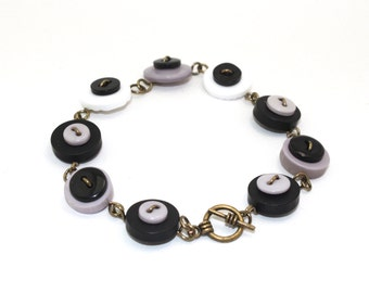 Wire button bracelet in gray white and black, antique brass wire wrapped