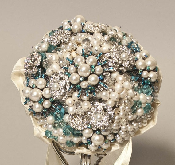 Brooch Bouquet of pearl and teal rhinestone brooches..