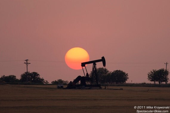 An Orange Sun Sets Behind an Oil Pump in Oklahoma