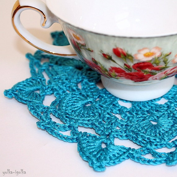 Two turquoise doilies, crocheted cotton with viscose. Coaster, placemat.