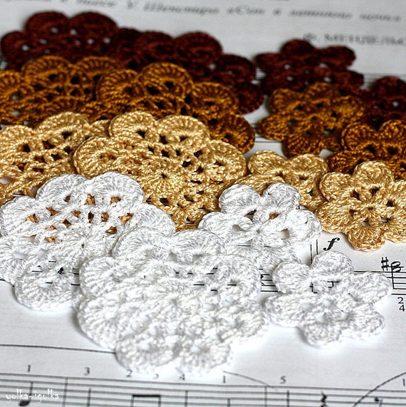 Floral motifs. Set of 16 crochet flower appliques. White, beige, gold and brown colors.