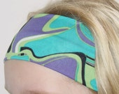 "aBANDin ""DeLite"" teal, purple, green, black and white print stretch headband"