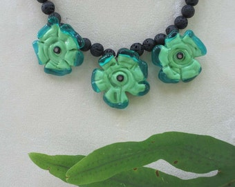 Handmade Lampworked Glass Bead Water Lily Necklace in Turquoise and Green with Black Lava Beads with Matching Earrings, OOAK Jewelry