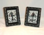 A pair of  Swarovski Crystal Embellished Frames with Cross and Fleur De Lis on Damask Background