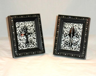 A pair of  Swarovski Crystal Embellished Frames with Cross and Fleur De Lis on Damask Background