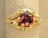 14 Karat Gold Garnet Ring with gold sea shells, sea horse & starfish