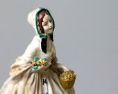 RESERVED for DIRA51 . vintage / antique chalkware statue . hand painted lady with bonnet and basket of flowers