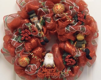 Red and green Christmas wreath with adorable Santa, Snowman and Moose