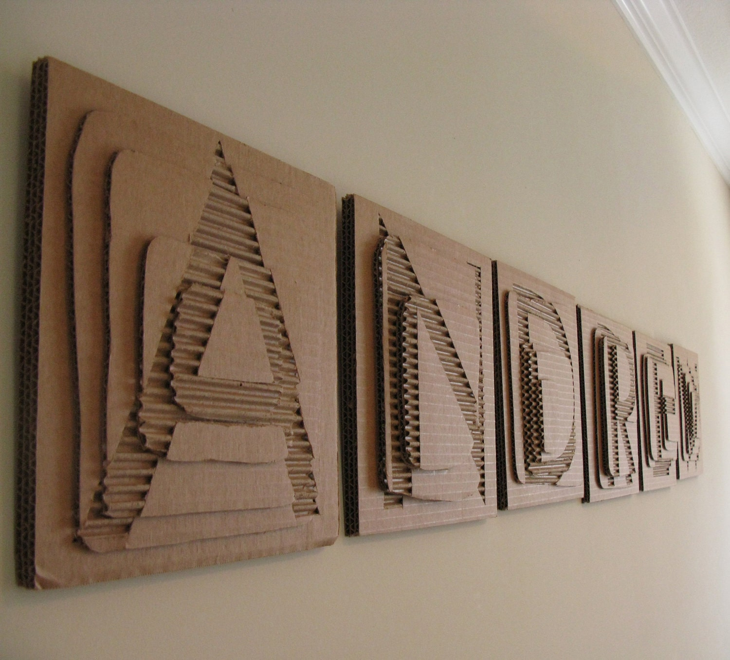 layered cardboard letters