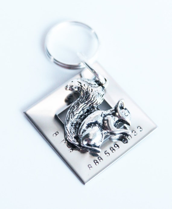 Metal name tag with squirrel charm