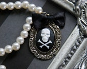 Skull cameo necklace - with a satin bow and a beaded chain