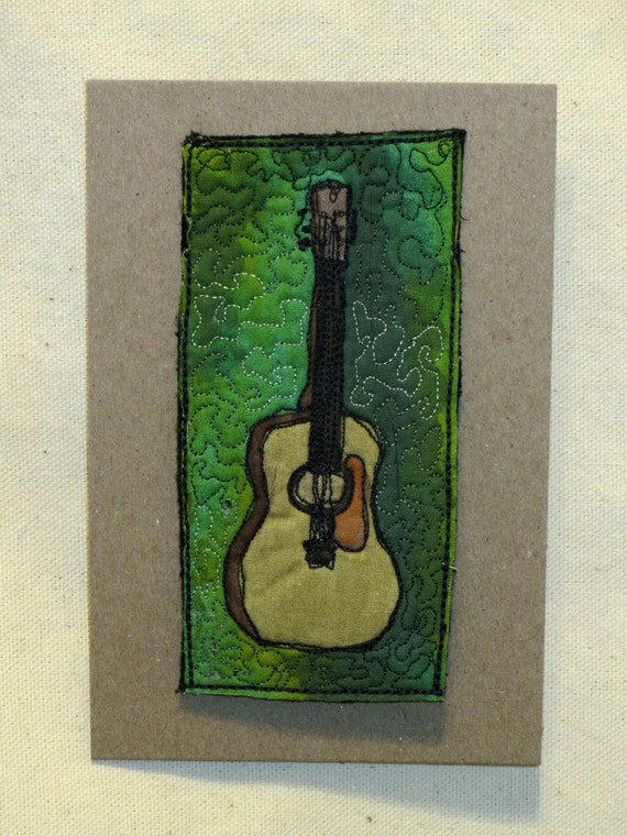 """Mini ArtQuilt - Acoustic Guitar (4x6"""", floating on greens )"""
