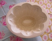 A vintage 19th century Victorian cream ceramic jelly mould by copeland
