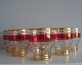 Set of six retro cranberry and gold striped shot glasses