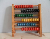 A vintage retro colourful wooden childrens abacus toy
