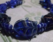 bracelet  beaded women's blue glass fishes and blue fiber-optic beads