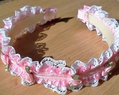 pink and white lace headband with pink ribbon flowers