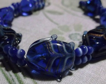 bracelet  beaded women's blue glass fishes and blue fiber-optic beads
