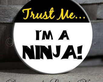 "TRUST ME I'm a NINJA on Black and White and Yellow Background - 1.5"" Pinback Button"