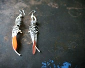 Pheasant and rib-bone earrings