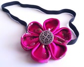 Flower headband, Pink Kanzashi, flower shaped headband about 3 inches around with a beautiful silver embellishment