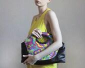 r e s e r v e d Oversized neon colors clutch handbag