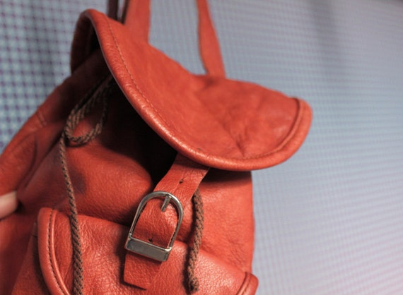 Leather backpack in bright brown orange