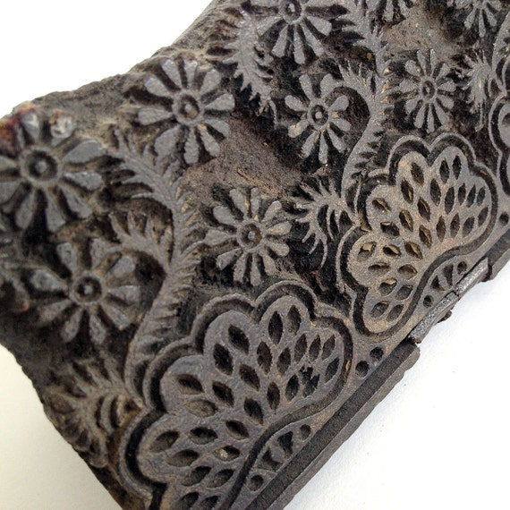 A beautiful wooden vintage hand carved printing fabric block