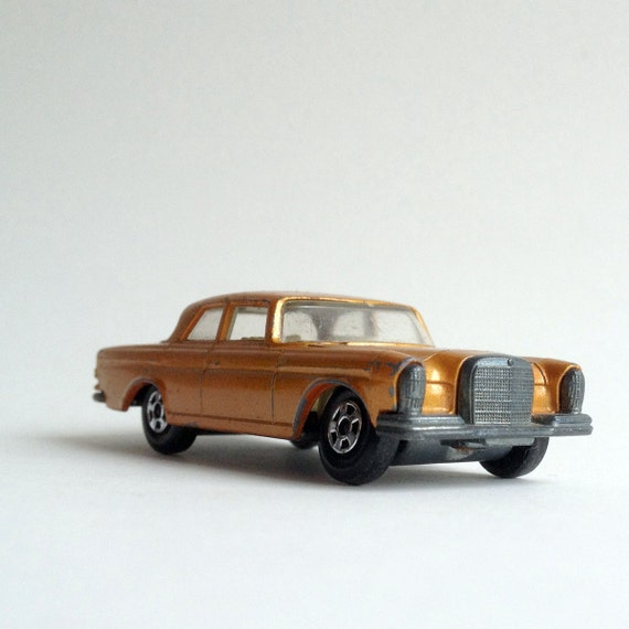 Luxury in a small vintage toy car, a gold Superfast Mercedes 300, made in England