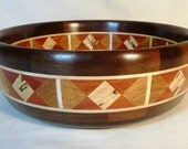 Segmented bowl with various domestic and exotic hardwoods.