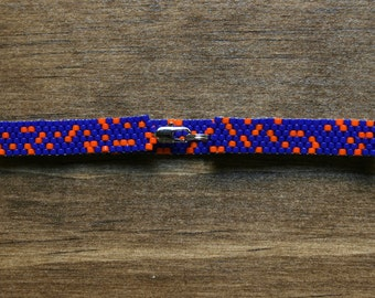 Deep Blue and Bright Orange Random Dot Patterned Peyote Bracelet