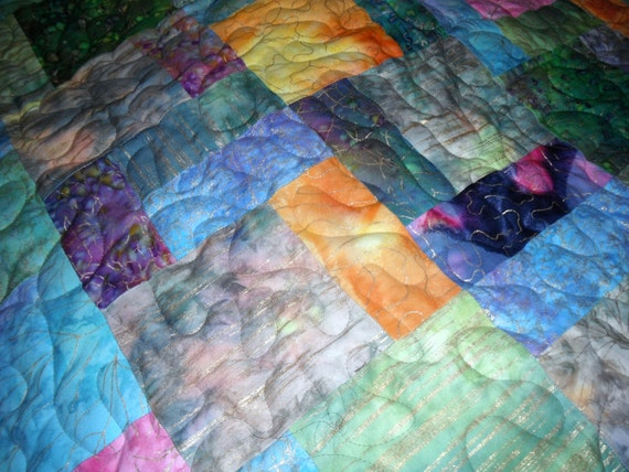 Throw size sofa quilt in many beautiful batik colors. RESERVED FOR LORRENE