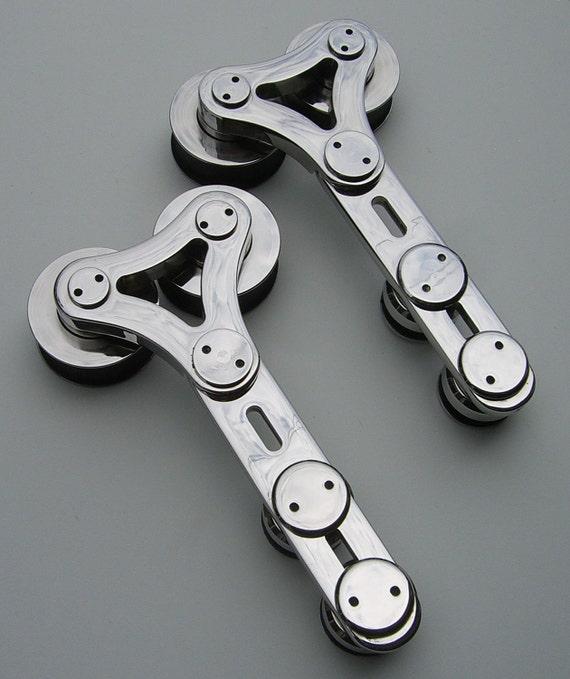 Stainless steel sliding glass door roller.
