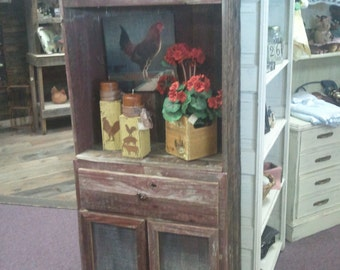 faded red barnwood hutch