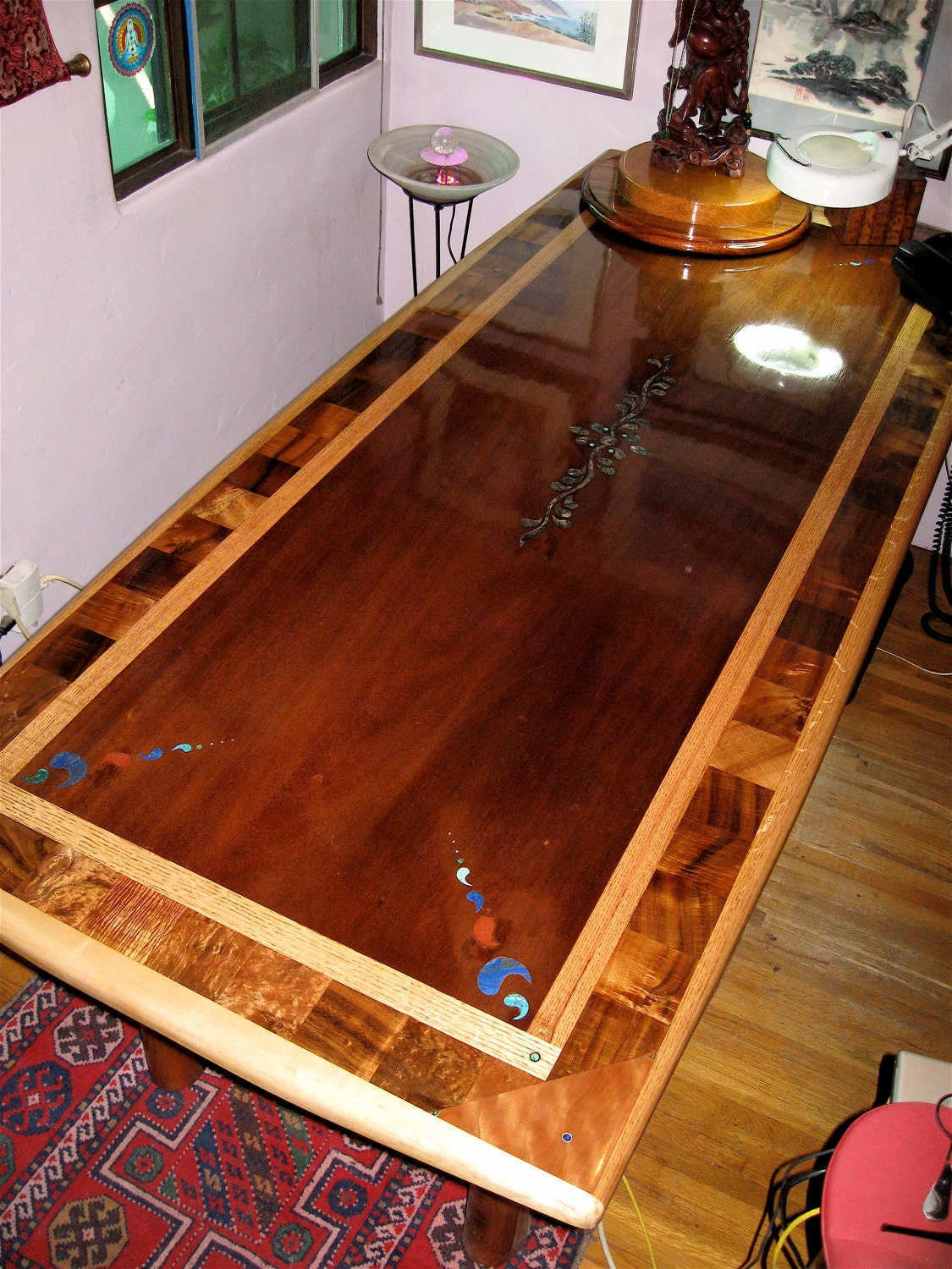Custom laminated exotic hardwood dining table with inlay