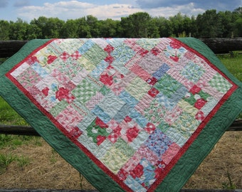 Handmade baby or lap quilt in retro fabrics, bright 1940's reproduction prints