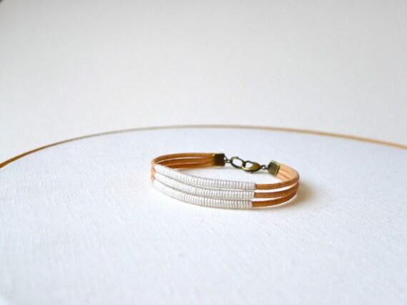 Multi strand cuff - light peach cotton thread wrapped