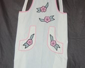 unique vintage full apron white muslin with pink trim and sewn on flowers with button on shoulder straps