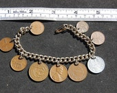 50's and 60's coin charm bracelet from around the world